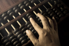 Human hand counting with abacus. Royalty Free Stock Image