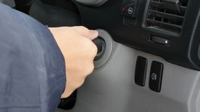 Human hand crank engine car key. stock footage