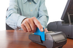 Human hand with credit card swipe through terminal for sale. Royalty Free Stock Photo