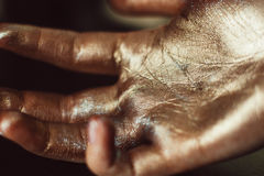 Human hand decorated with gold dust Royalty Free Stock Photo
