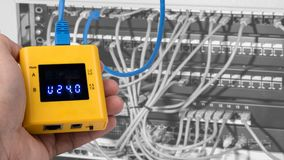 Testing of PoE on cables connected in patch panels of rack case royalty free stock photo