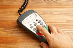Human hand dials the code on payment terminal Stock Photo