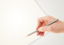 Human hand drawing with pencil on empty paper template Royalty Free Stock Photo