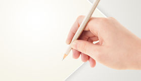 Human hand drawing with pencil on empty paper template Royalty Free Stock Photos