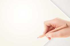 Human hand drawing with pencil on empty paper template Stock Photography