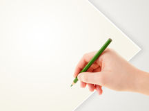 Human hand drawing with pencil on empty paper template Royalty Free Stock Photography