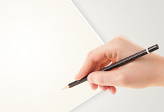 Human hand drawing with pencil on empty paper template Stock Images