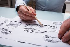 Human Hand Drawing Sketch Of A Car. With Pencil On Paper stock photography