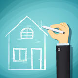 Human hand draws a sketch of the house. Design architecture. Sto Royalty Free Stock Photo