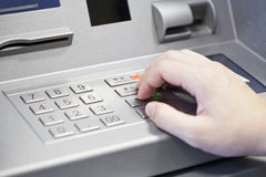 Human hand enter atm banking cash machine pin code Royalty Free Stock Photos