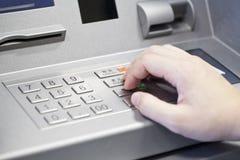 Human hand enter atm banking cash machine pin code Royalty Free Stock Photos