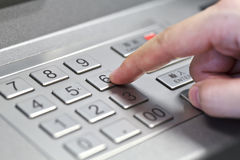 Human hand enter atm banking cash machine pin code Royalty Free Stock Image