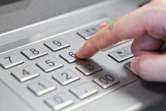Human hand enter atm banking cash machine pin code Royalty Free Stock Image