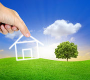 Human hand fill home on the beautiful land Royalty Free Stock Images