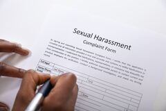 Free Human Hand Filling Sexual Harassment Complaint Form With Pen Stock Images - 181436984