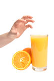 Human hand and fresh juicy orange Royalty Free Stock Photo