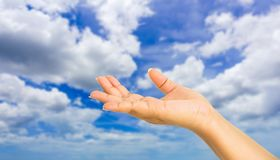 Human hand gesture something with sky background stock photography