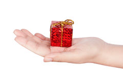 Human hand with a gift box. Human hand with a birthday gift box Royalty Free Stock Photo