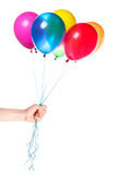 Human hand gives flying balloons Royalty Free Stock Photo