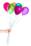 Human hand gives flying balloons Stock Photos
