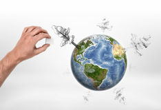 Human hand with a globe and drawn trees. Deforestation.Tree Protection. Environment and ecology. Save planet Stock Photo