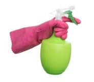Human hand in glove holding sprayer bottle Stock Photo