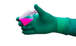 A human hand in glove with liquid. A human hand with pink liquid in a bodle Stock Photo