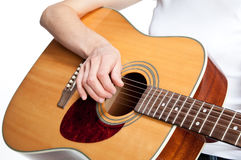 Human hand on a guitar Royalty Free Stock Images