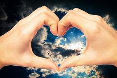 Human hand heart. Isolated on a sky background Royalty Free Stock Images