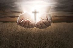 Human hand hold christian cross. Religion concept royalty free stock photos