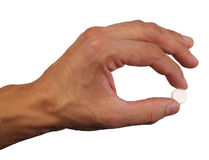 Human hand hold one pill in fingers Royalty Free Stock Image