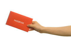 Human hand hold passbook on isolated white background. Stock Photos
