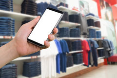 Human hand hold smartphone, tablet, cell phone with blurry Cloth Stock Photo