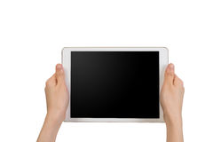 Human hand hold white tablet with blank screen on isolated white background. royalty free stock photo
