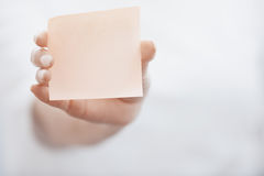 Human hand holding adhesive note Stock Images