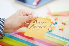 Do not forget text on adhesive note royalty free stock photo