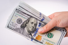Human hand holding American dollar banknotes on white background Stock Photos