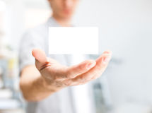 Human hand holding blank business card Royalty Free Stock Photos