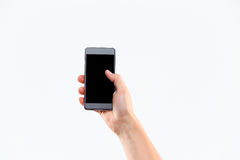 Human hand holding blank large mobile smart phone Royalty Free Stock Photo