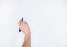 Human hand holding blue ball pen. White background Royalty Free Stock Photos