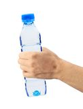Human hand holding a bottle of water isolated. On white Stock Photos