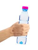Human hand holding a bottle of water Stock Images