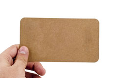 Human hand holding card. Human Hand Holding Empty Yellow paper Card on isolated white background Royalty Free Stock Images