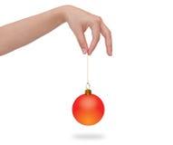 Human hand holding Christmas ball. Stock Photo