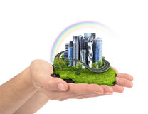 Human hand holding the city. Royalty Free Stock Images