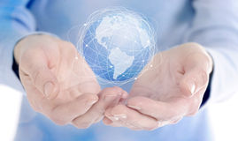 Human hand holding digital icon of planet earth royalty free stock images