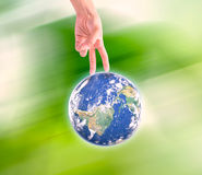 Human hand holding Earth planet. Elements of this image are furn Stock Photography