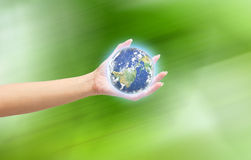Human hand holding Earth planet. Elements of this image are furn Royalty Free Stock Photo