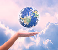 Human hand holding Earth planet. Elements of this image are furn Royalty Free Stock Images