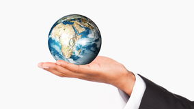 Human hand holding the Earth Planet. World protection Royalty Free Stock Image